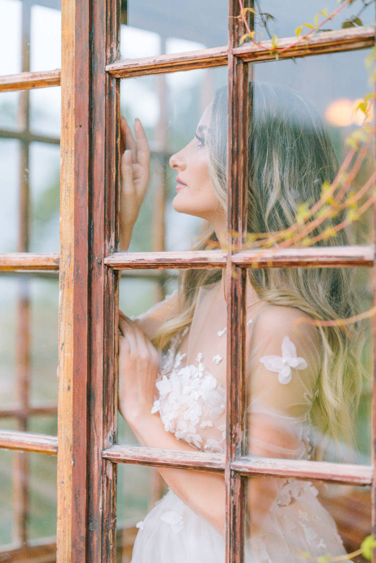 Bride at Wooden Windows - Castle Wedding in Romania