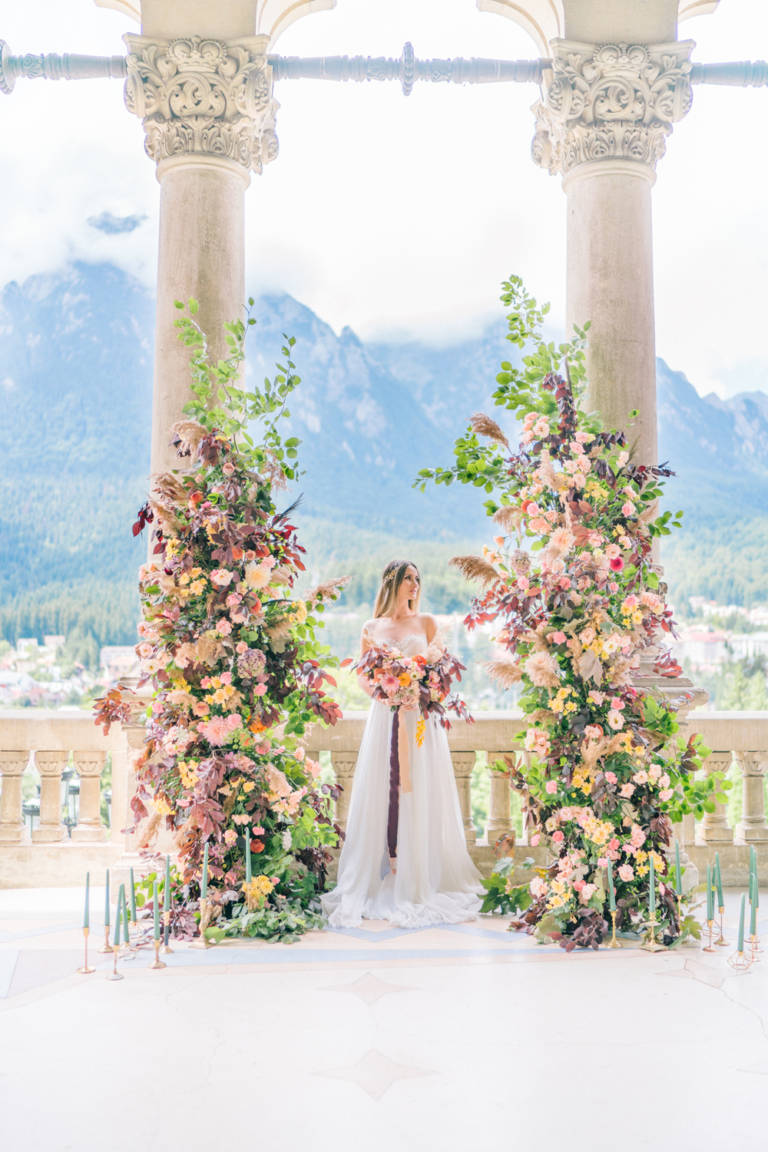 Bride on balcony with panoramic mountain view